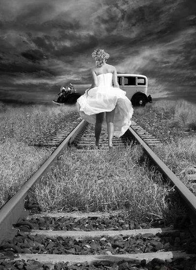 Woman Walking on Tracks
